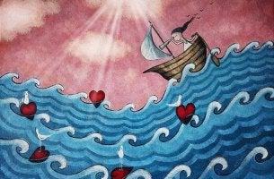Niña navegando por el mar con corazones