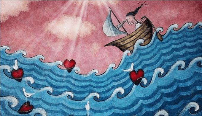 Niña navegando por el mar de corazones