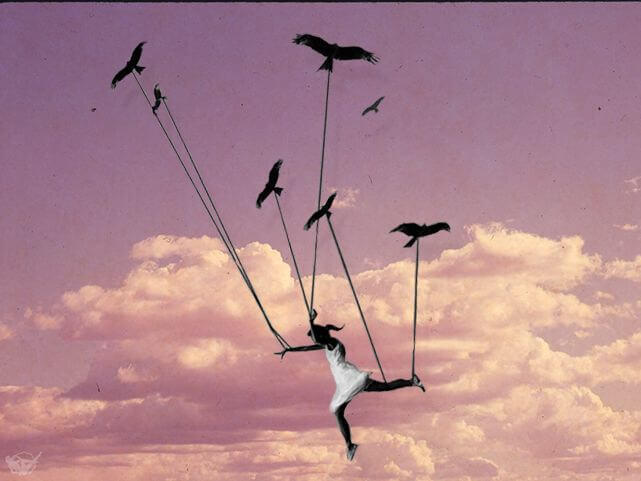 Niña volando sujetada con cuerdas por pájaros