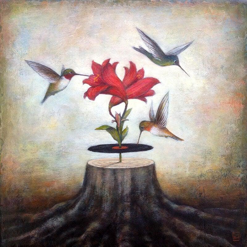 Pájaros volando alrededor de una flor
