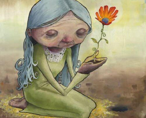 Anciana con una flor en sus manos