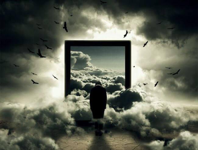 hombre frente a ventana con nubes