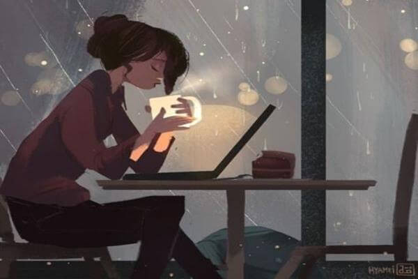joven bebiendo cafe por la noche