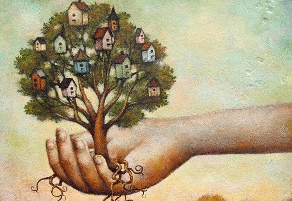 mano sujetando árbol