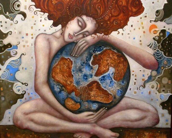 Mujer abrazando una bola del mundo