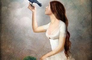 Mujer con un pájaro reflxionando en proverbios árabes representando cuando nada te hace feliz