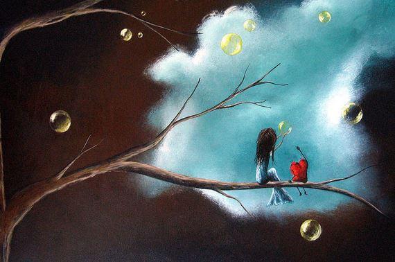 Niña y corazón mirando a la luna