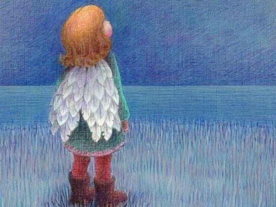 Niño mirando con alas al cielo