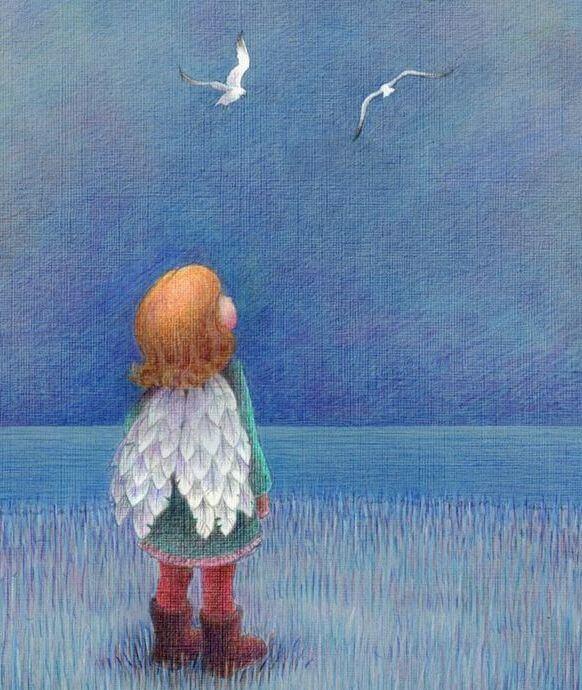 niño con alas mirando el cielo