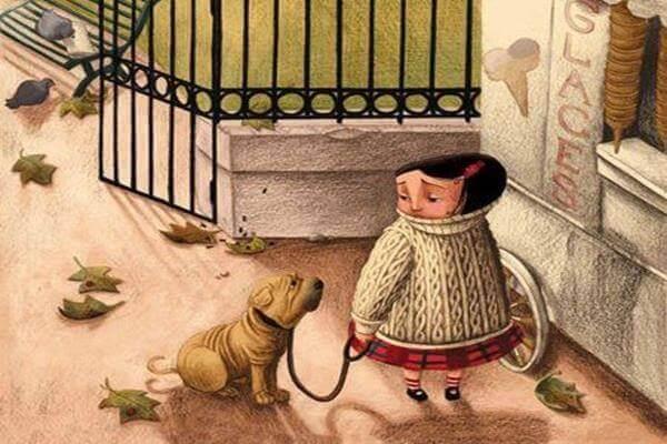 Niña en un parque con un perro
