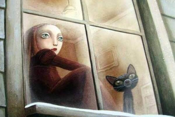 Niño con un gato en una ventana pensando en familias narcisistas