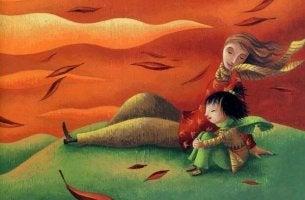 Padre y niño sentados hablando en una montaña