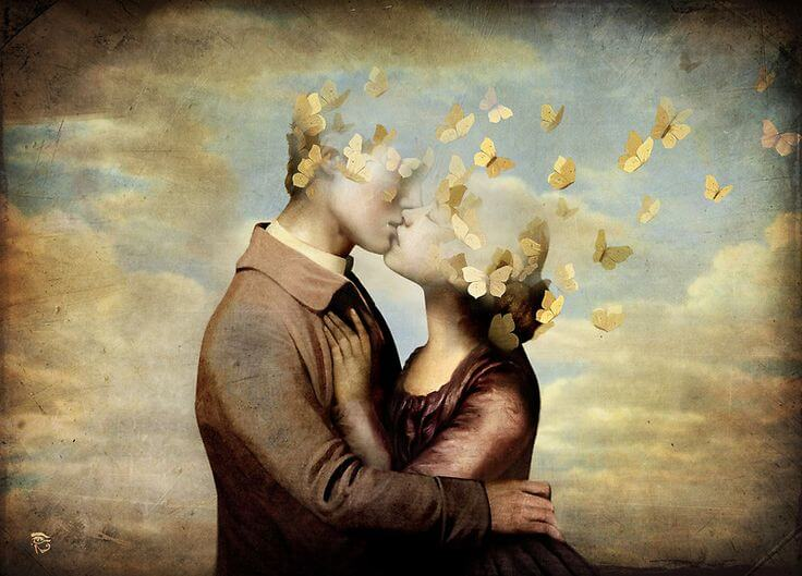 pareja besándose con cabeza en forma de mariposas