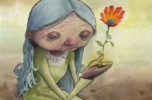 Mujer con una flor en sus manos