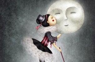 Mujer dando un beso a la luna