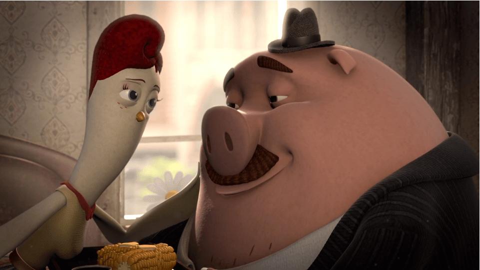 Gallina y cerdo mirándose