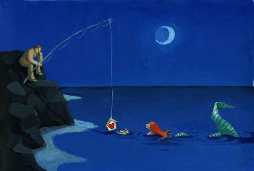 Hombre con una caña de pescar con un corazón y una sirena