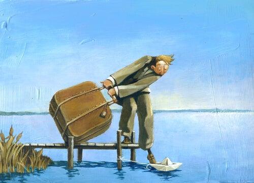 Hombre con maleta y un pie en un barco de papel