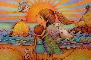 Madre abrazando a su hija en la playa al atardecer