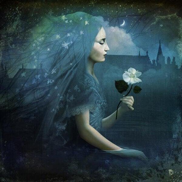 Mujer sujetando una rosa blanca