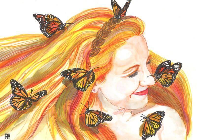 Mujer sonriendo rodeada de mariposas
