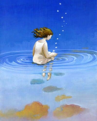 Niña con los pies en el agua