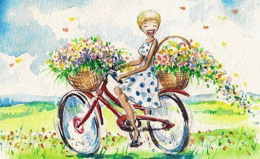 Niña en bicicleta riéndose