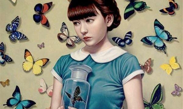 Niña rodeada de mariposas