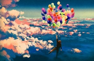 Niño volando con globos
