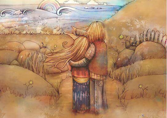 Pareja abrazada viendo el arco iris