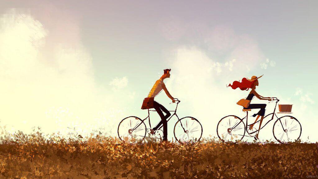 Pareja paseando en bicicleta