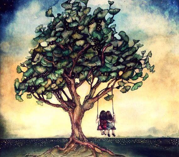 Amigas sentadas en un columpio bajo un árbol