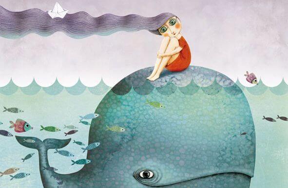 Chica sentada sobre una ballena