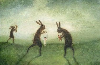 conejos mostrando la manipulación de unas marionetas