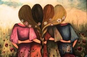 Cuatro amigas de espaldas abrazadas