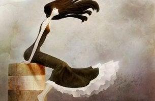 Chica joven sentada soñando