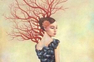 Mujer al lado de un arbol pensando