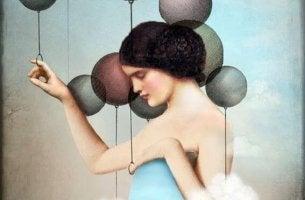 Mujer con globos pensando