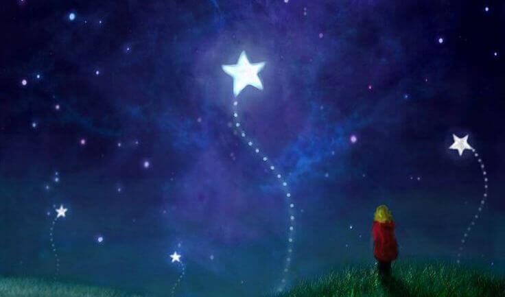 Niño mirando una estrella