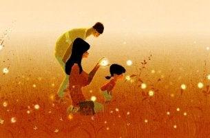 Padres con hijo en el campo