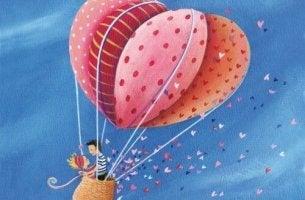 Pareja subida a un globo disfrutando de su amor