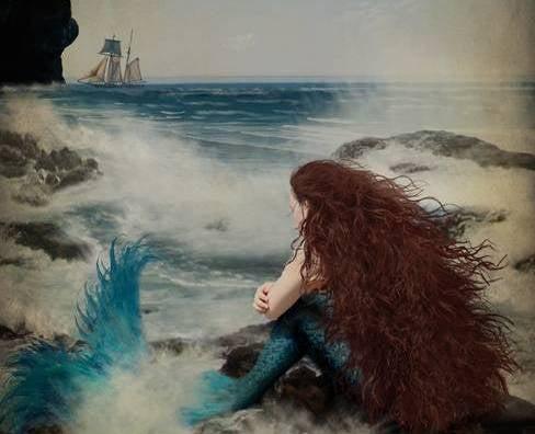 sirena mirando barco