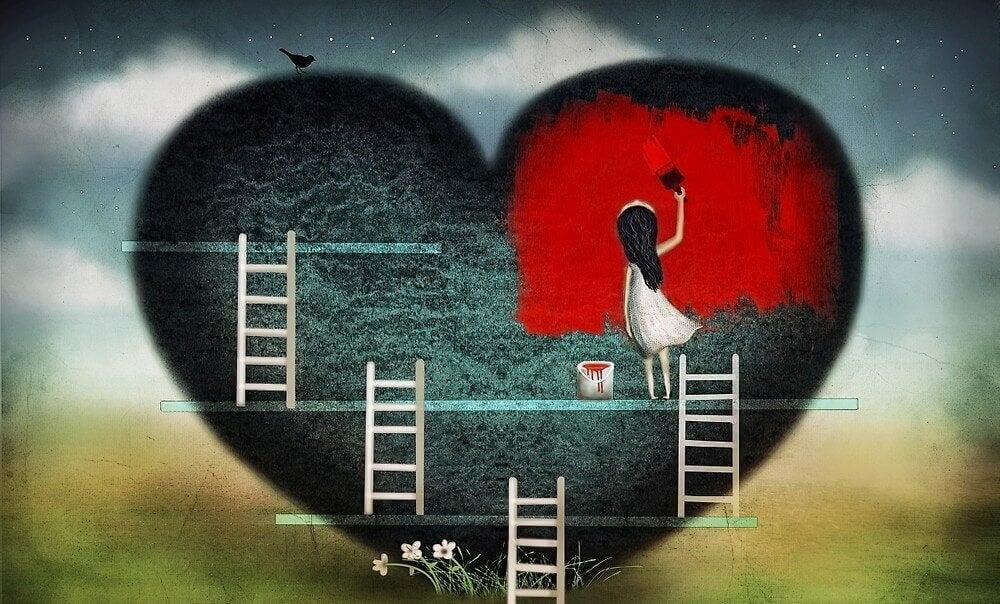 Niña pintando un corazón de rojo
