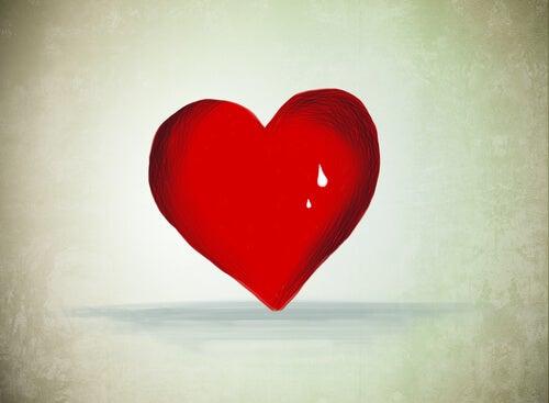 Corazón rojo con lágrima