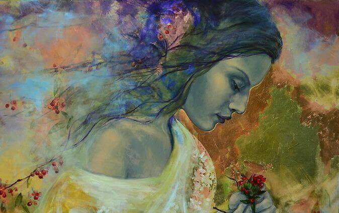 Mujer-con-flores-en-la-mano.jpg?profile=RESIZE_710x