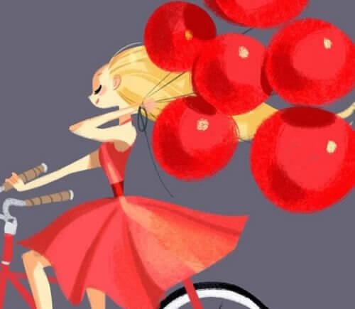 mulher-bicicleta-com-baloes-vermelhos