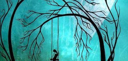 Mujer triste en un columpio por la noche