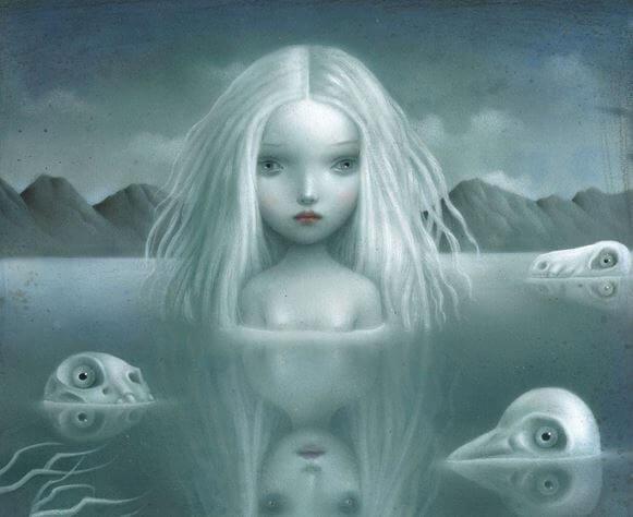 Mujer triste en un lago