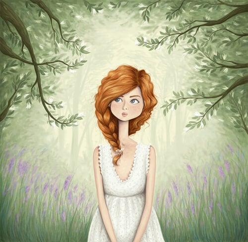 Chica pensativa en el bosque