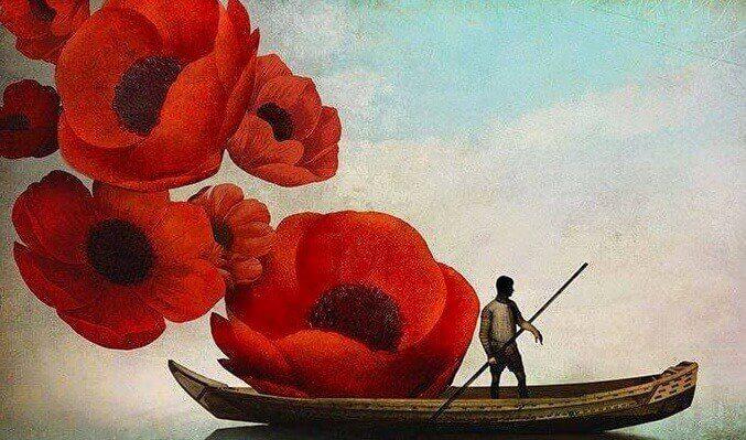 Hombre navegando entre flores
